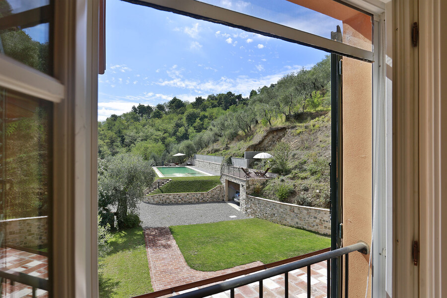 View over the private pool in the vacation villa in Lucca